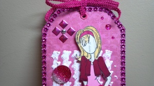 Fuschia Prima Doll Tag Close Up 1